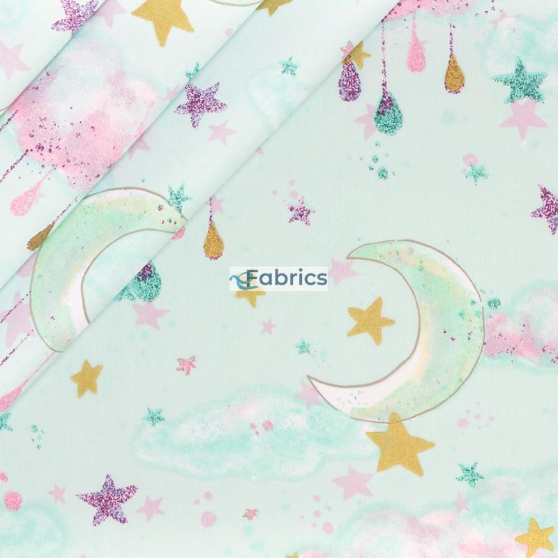 Księżyce i gwiazdki na miętowym tle