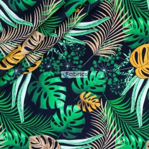 Duże liście palmowe na czarnym tle